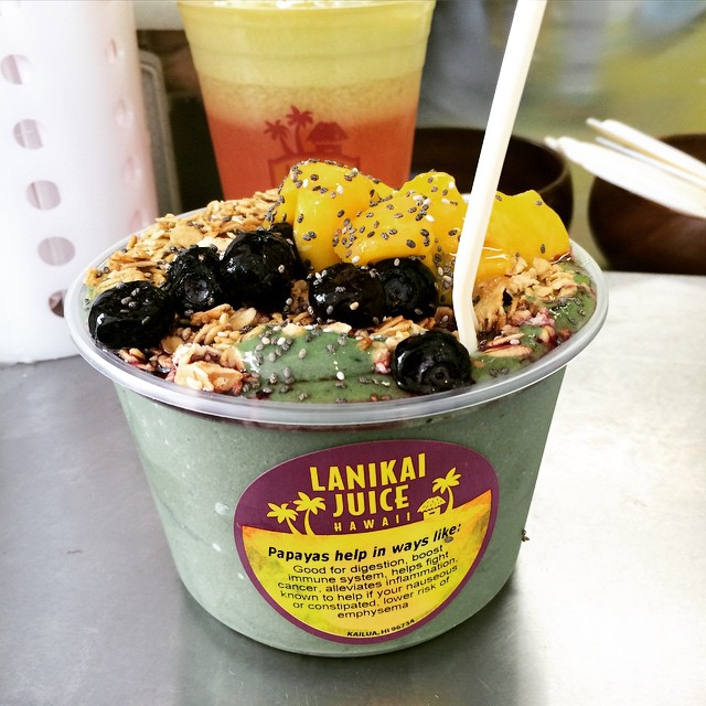 "My green acai bowl from lanikaijuice in hawaii : ""the mana green bowl"" with kale, spinach, orange, mango, papaya, chia seeds, blueberries, and extra added protein."